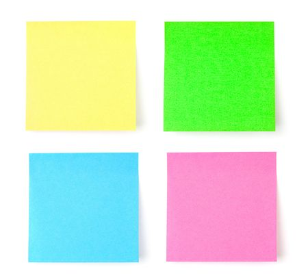 Multicolored postit note paper isolated on white background photo