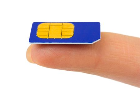 sim: Sim card on finger isolated on white background