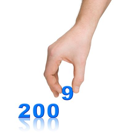 Numbers 2009 and hand isolated on white background photo