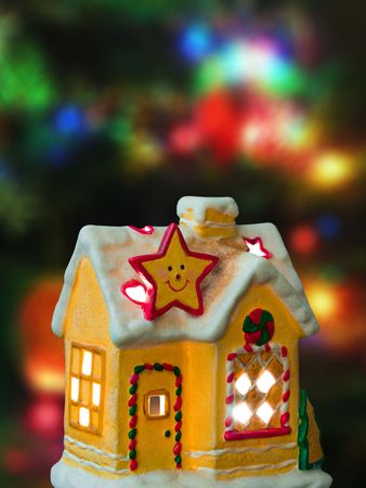 Lighting house, abstract christmas tree on background photo