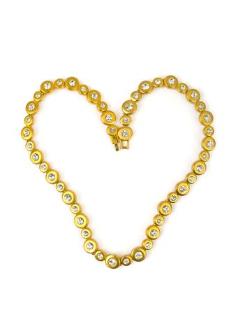 Heart made of gold chain isolated on white background photo