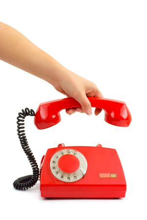 Telephone and woman hand isolated on white background Stock Photo - 3976256