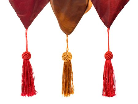 coziness: Textile and tassels isolated on white background