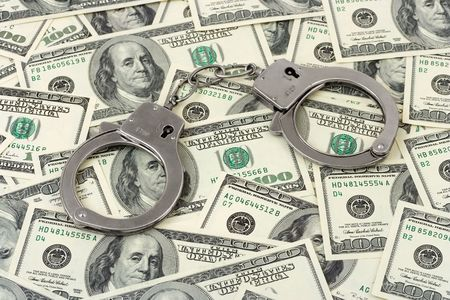 snitches: Handcuffs on money background, business security concept