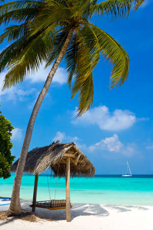 Swing on a tropical beach, vacation symbol photo