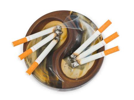 Ashtray and cigarettes isolated on white background photo