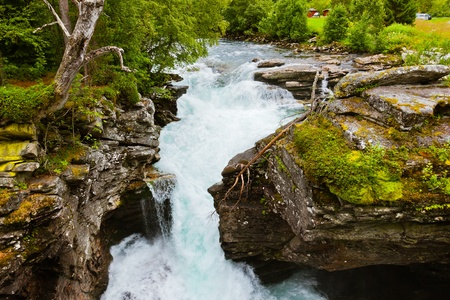 scandinavian landscape: Waterfall near Geiranger fjord Norway - nature and travel background Stock Photo