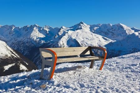 Bench at mountains ski resort Bad Gastein Austria - nature and sport background photo