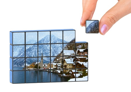 Hand and winter Austria (my photo) puzzle isolated on white background photo