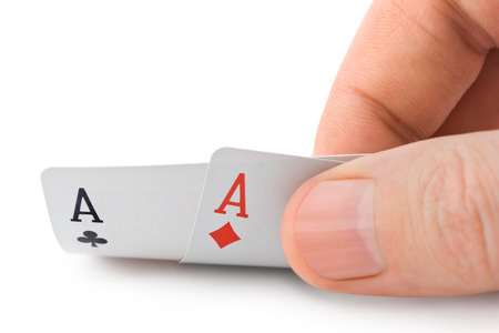 Hand and aces isolated on white background Stock Photo
