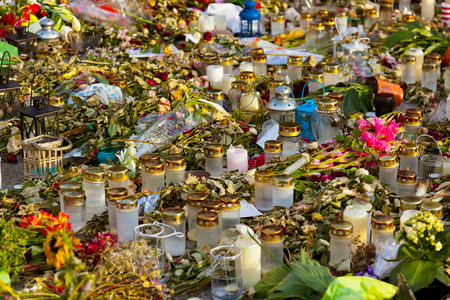 Candles and flowers in cemetery - abstract background photo