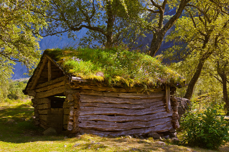 barrack: Old house near Briksdal glacier - nature and travel background