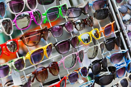 Stylish multicolored sunglasses - shopping background photo