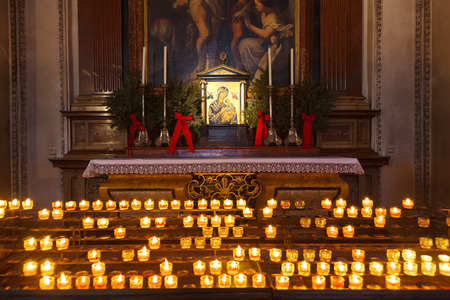 Icon and candles in cathedral at Salzburg Austria - religion background photo
