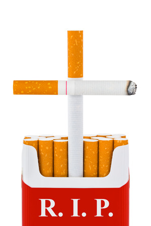 Grave made of cigarettes isolated on white  photo