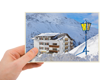 Mountains ski resort (Austria) photography in hand (my photo) isolated on white background photo