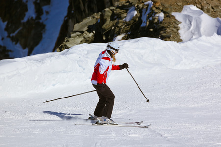 Skier at mountains ski resort Innsbruck Austria - nature and sport background photo