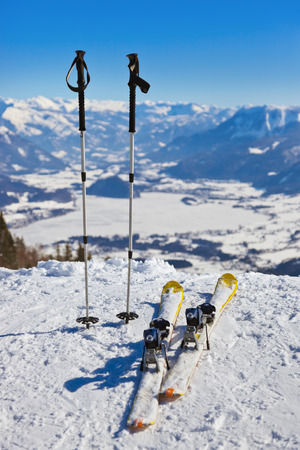 Mountains skis and ski-sticks - St. Gilgen Austria - nature and sport background photo