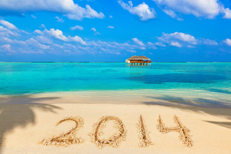 Numbers 2014 on beach - concept holiday background Stock Photo