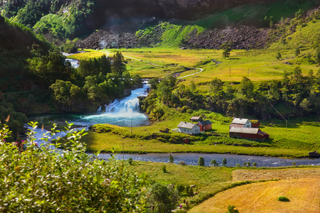waterfall in the city: Village in Flam - Norway - nature and travel