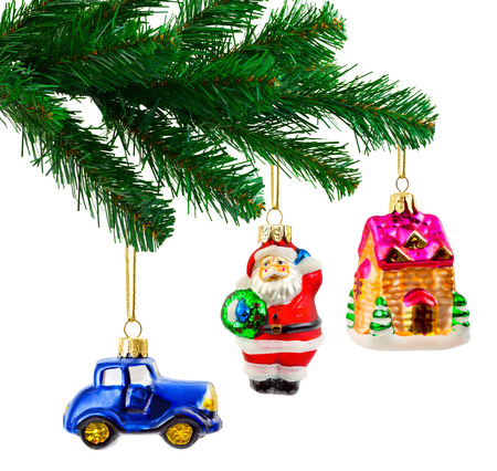 Christmas tree and toys isolated on white  photo