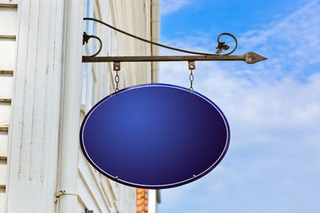 metal plaque: Blank blue sign