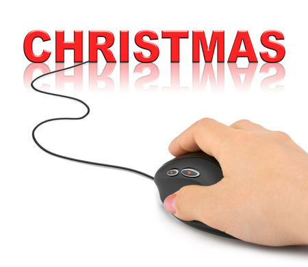 Hand with computer mouse and Christmas - holiday concept photo
