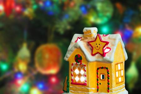Lighting house - christmas tree on background photo