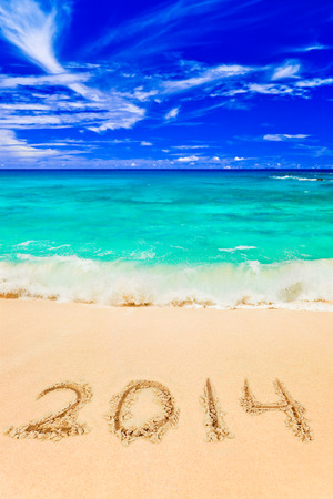 maldives island: Numbers 2014 on beach - concept holiday background Stock Photo