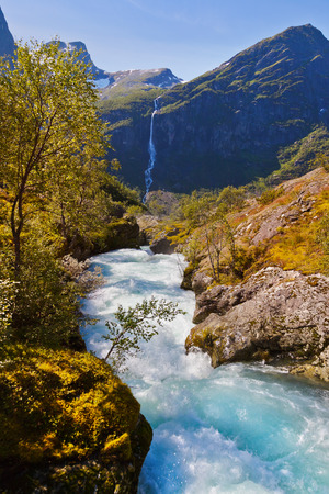 scandinavian landscape: Waterfall near Briksdal glacier - Norway - nature and travel background Stock Photo