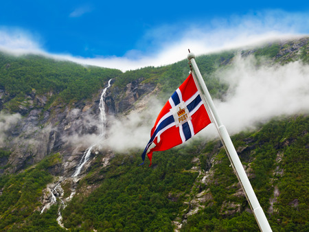 Norway flag and waterfall - nature and travel background photo