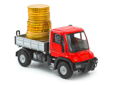 Toy car truck with money isolated on white background photo