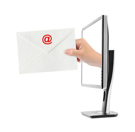 Hand with letter and computer monitor isolated on white background photo