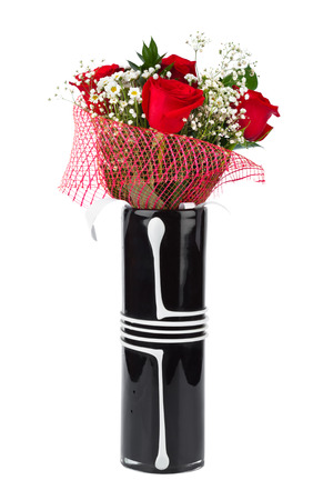 Roses in vase isolated on white background photo