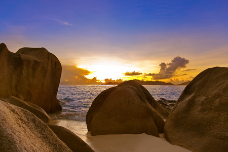 anse source d argent: Sunset on tropical beach Source DArgent at Seychelles - nature background Stock Photo