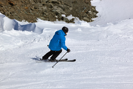 Skier at mountains ski resort Innsbruck Austria - nature and sport background photo