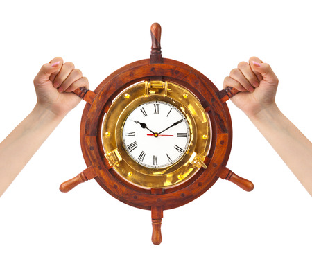 Hands and helm clock - time management concept photo