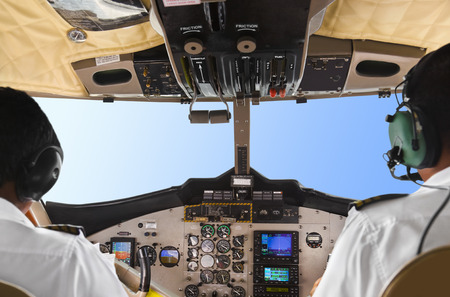 Pilots in the plane cockpit and blue sky photo
