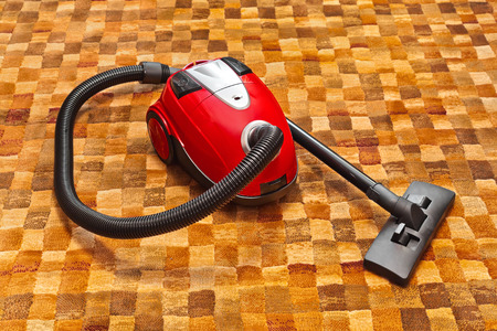 dry cleaner: Vacuum cleaner on carpet - technology housework Stock Photo