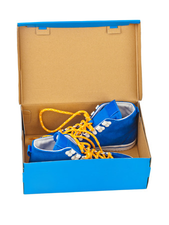 Sneakers in box isolated on white background photo