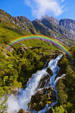 rainbow bridge: Waterfall near Briksdal glacier - Norway - nature and travel background Stock Photo
