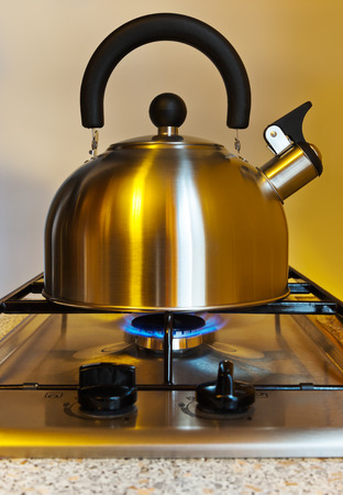 Stovetop whistling kettle - cooking kitchen background photo