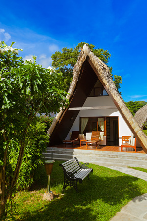 Hotel at tropical beach - vacation background photo