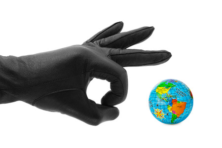 Hand and globe isolated on white background photo