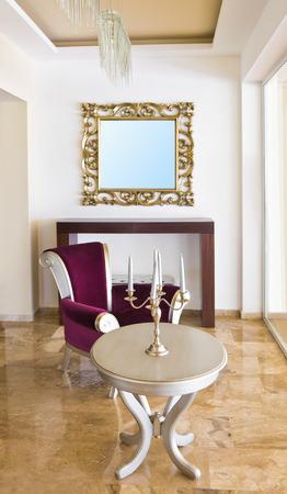 Classic retro interior - armchair, table, mirror photo