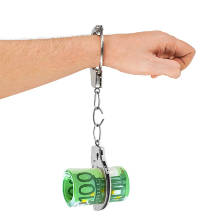 Hand with breaking handcuffs and money isolated on white background photo