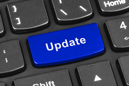 news update: Computer notebook keyboard with Update key - technology background Stock Photo