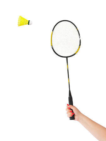 Hand with badminton racket isolated on white background photo