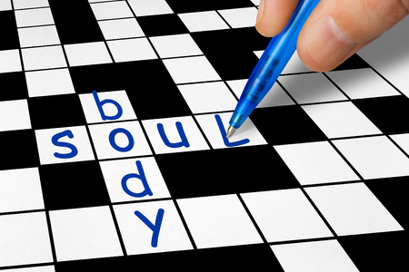 filling in: Hand filling in crossword - Soul and Body