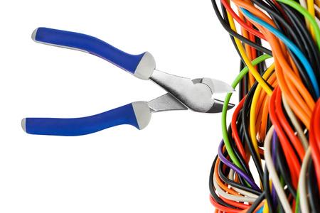 alicates: Alicates y cable aislado en fondo blanco Foto de archivo